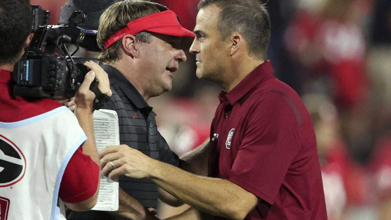 Georgia coach Kirby Smart shakes hands with South Carolina coach Shane Beamer, right, after an...