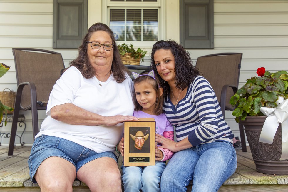 From left, Teresa, Kensley, and Kelli Kersey sit for a portrait outside home after an interview...
