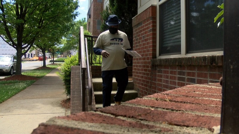 Robert Dawkins with Action NC left pamphlets at the Seigle Point Apartment Homes.
