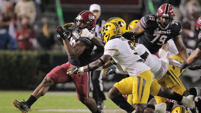 South Carolina running back Kevin Harris (20) struggles to gain yards against Missouri during...