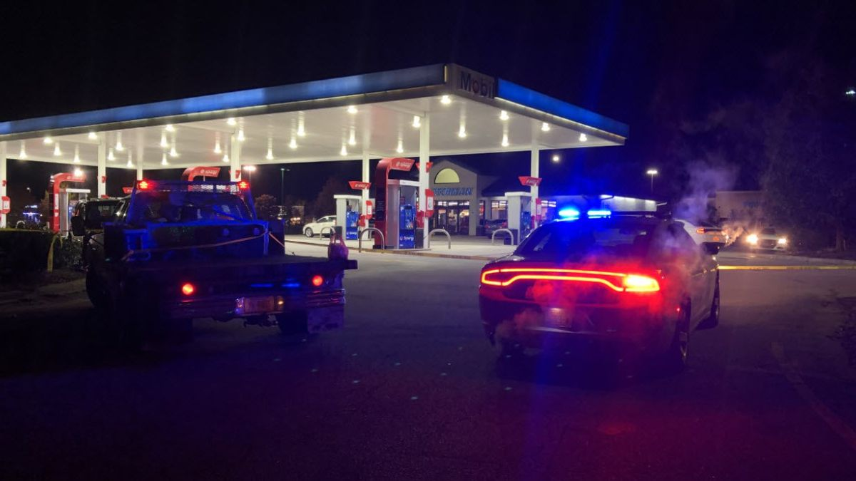 A man working at a convenience store was shot to death while defending his mother during an...