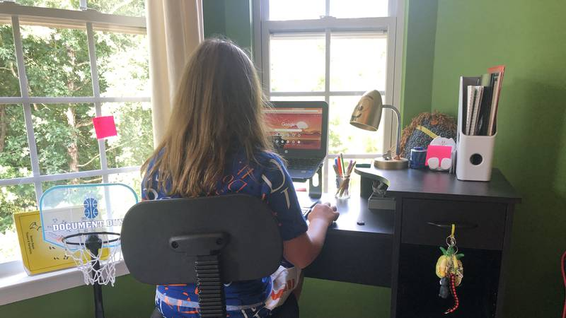 A CMS student logs onto to the Canvas server for remote learning at home.