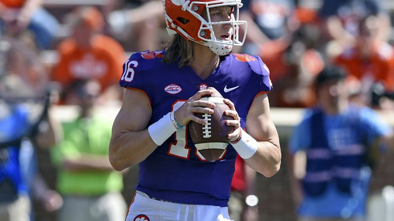 Clemson's Trevor Lawrence drops back to pass during Clemson's annual Orange and White NCAA...