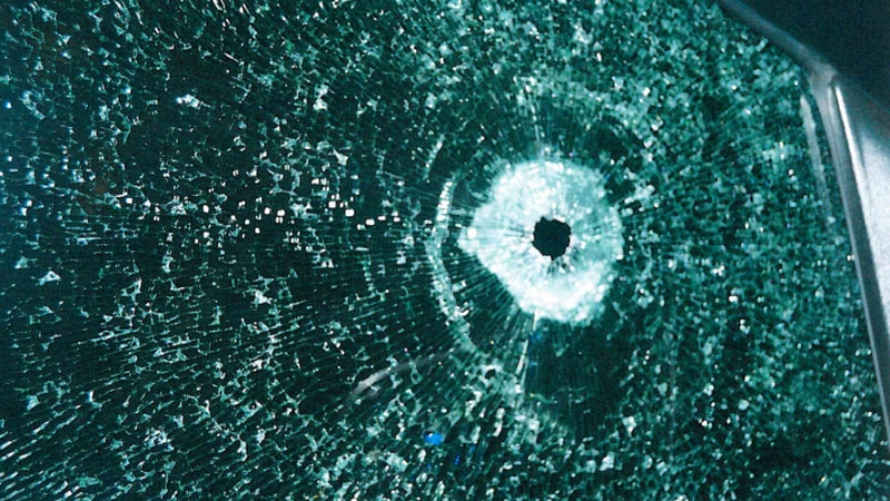 The investigation shows this picture of a gunshot in the front passenger glass of a Rowan...