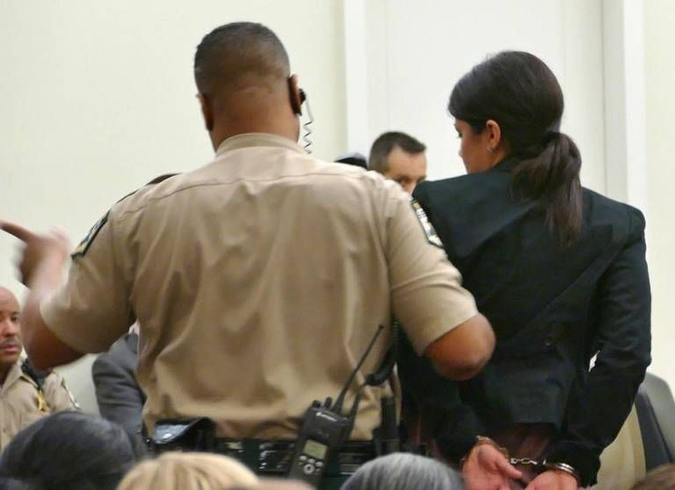 Kelly Ann Conkin is led away after being sentenced for the death of Cecelia Buitrago de...