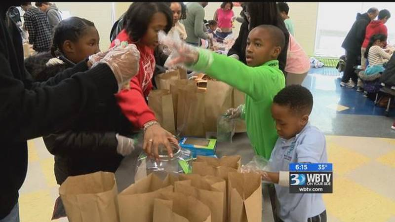 Volunteers hand out food on MLK Jr Day
