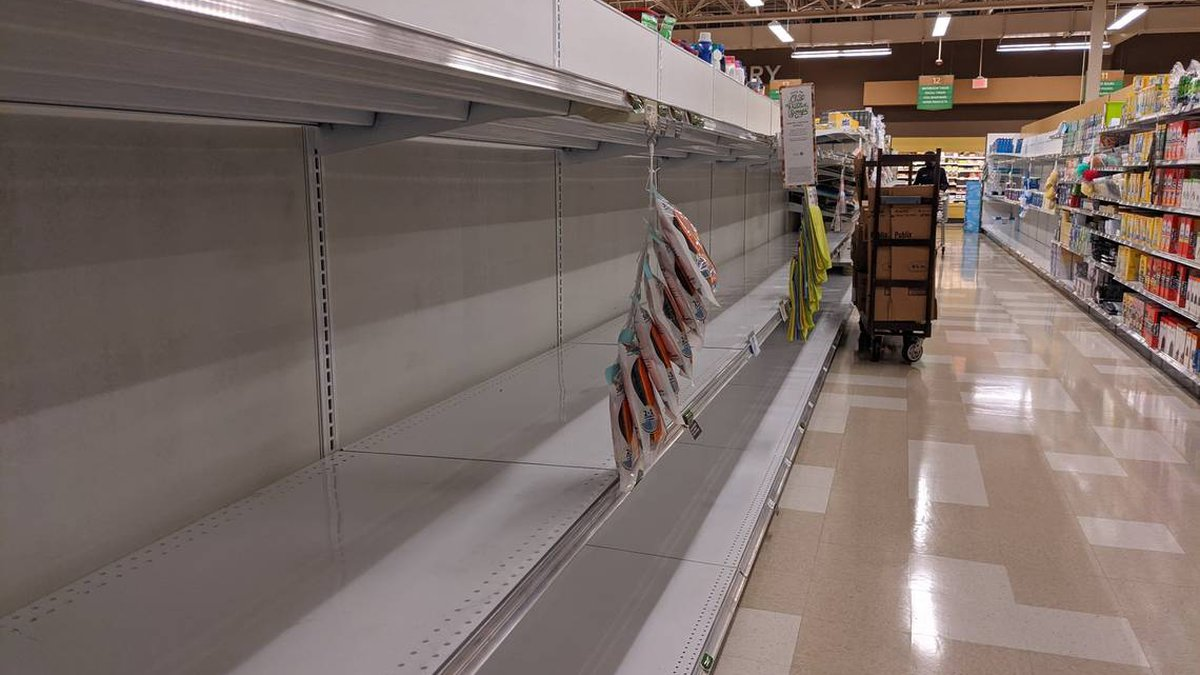 Shelves for paper towels were empty Friday morning at the Publix store on South Tryon Street in...