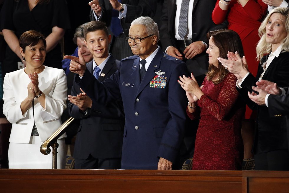 Tuskegee airman Charles McGee, 100, and his great grandson Iain Lanphier react as President...