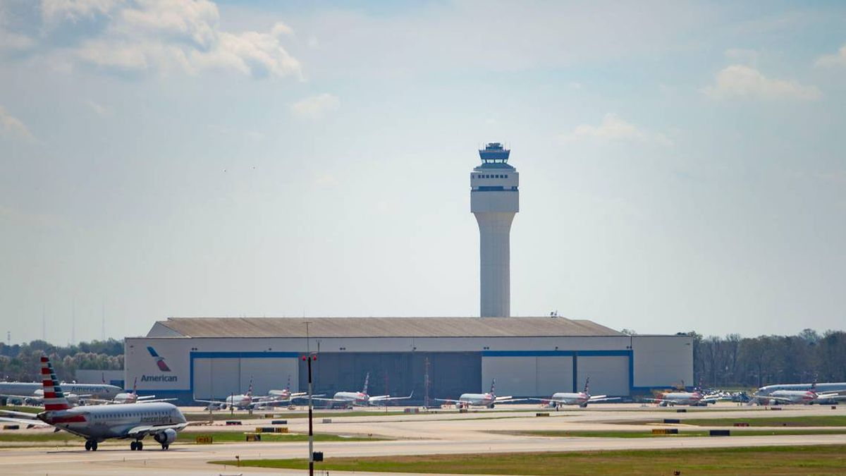 Planes sit idle at the American Airlines hanger at the Charlotte Douglas International Airport...