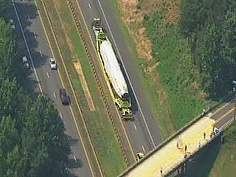 People waved as the plane made its way on I-77 South to Charlotte Friday morning.