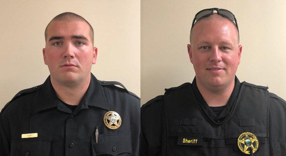 Watauga County Sheriff's Office K-9 Deputy Logan Fox (left) and Sgt. Chris Ward (right)