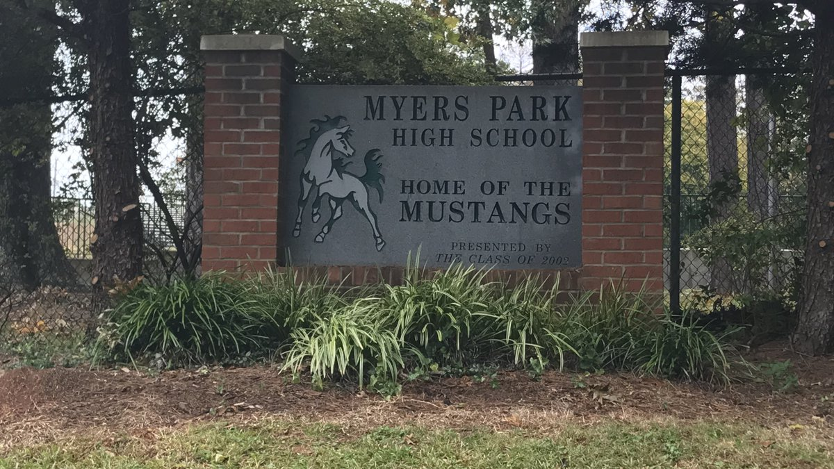 A sign sits at an entrance to Myers Park High School