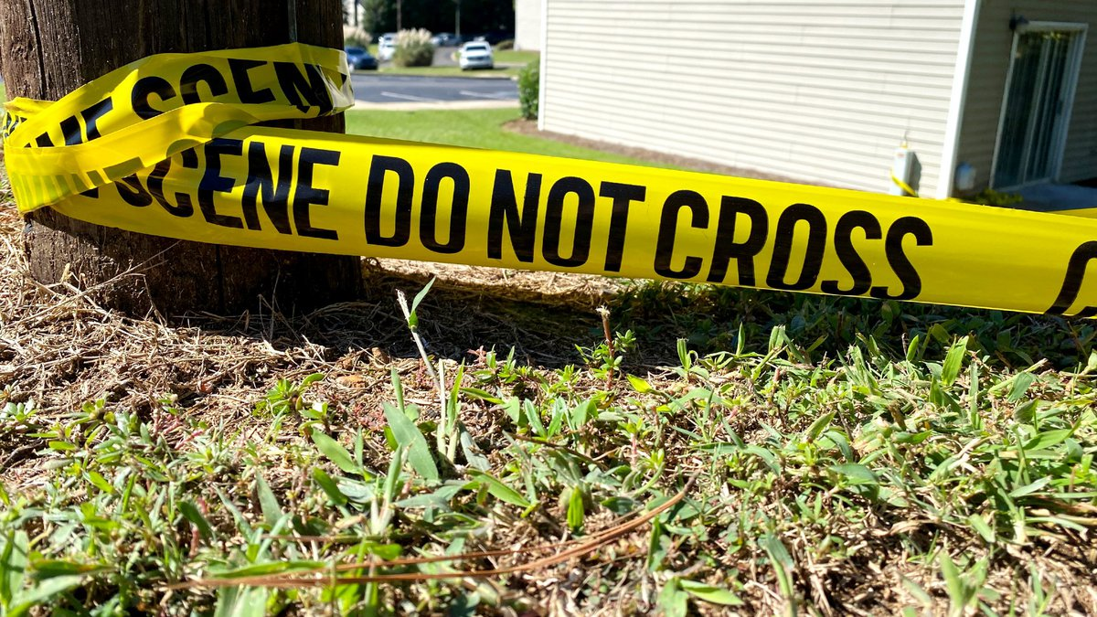 This was the scene Friday morning outside an apartment where four people were shot dead in Aiken.