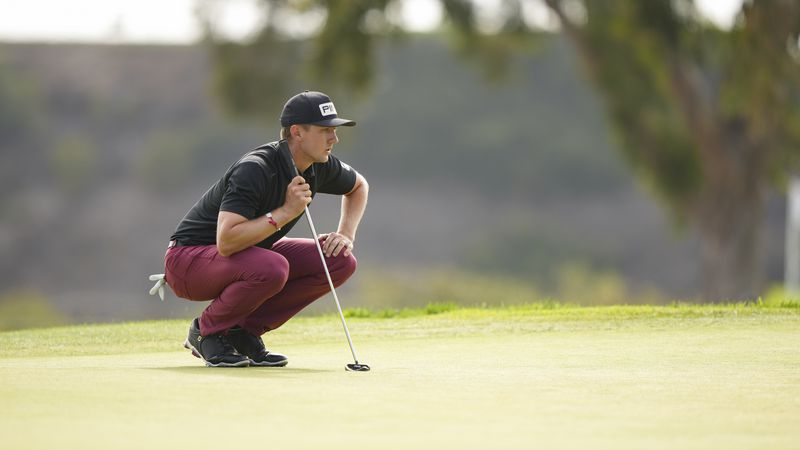 Mackenzie Hughes lines up his putt on the 17th green during the third round at the 2021 U.S....