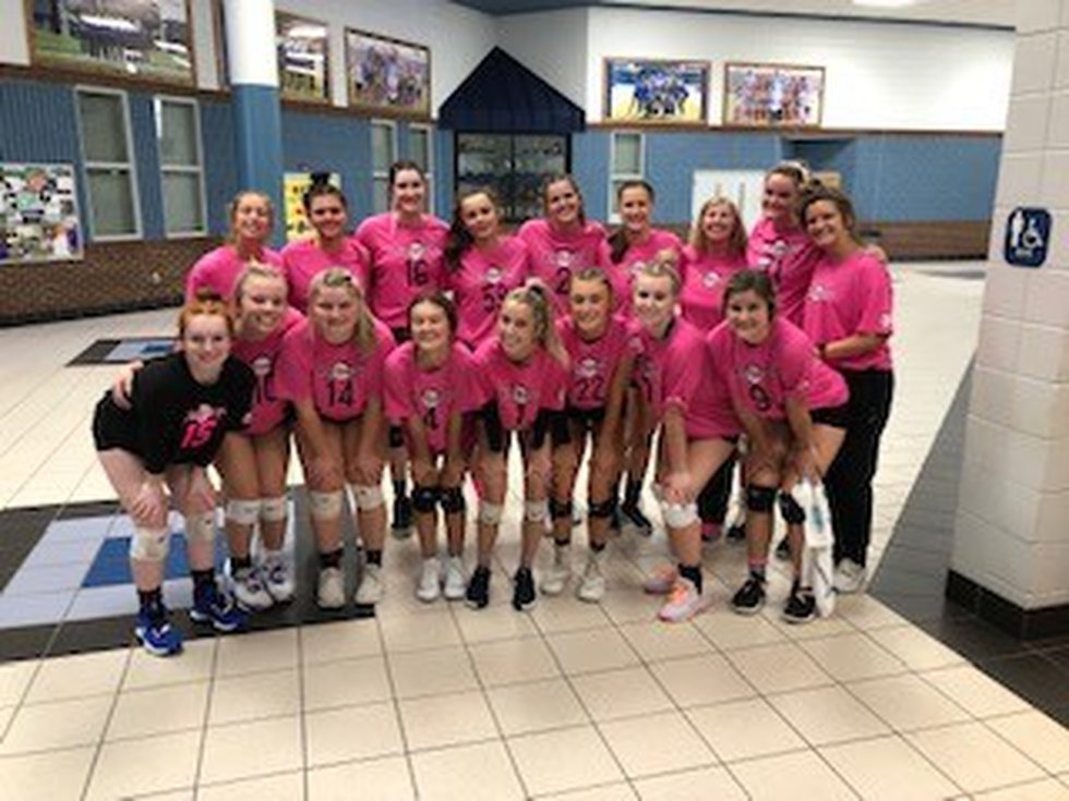 North Lincoln played Fred T. Foard High School - both teams wore pink.  Then both teams posed...