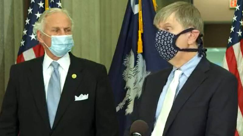 Dr. Edward Simmer, right, director of the South Carolina Department of Health and Environmental...