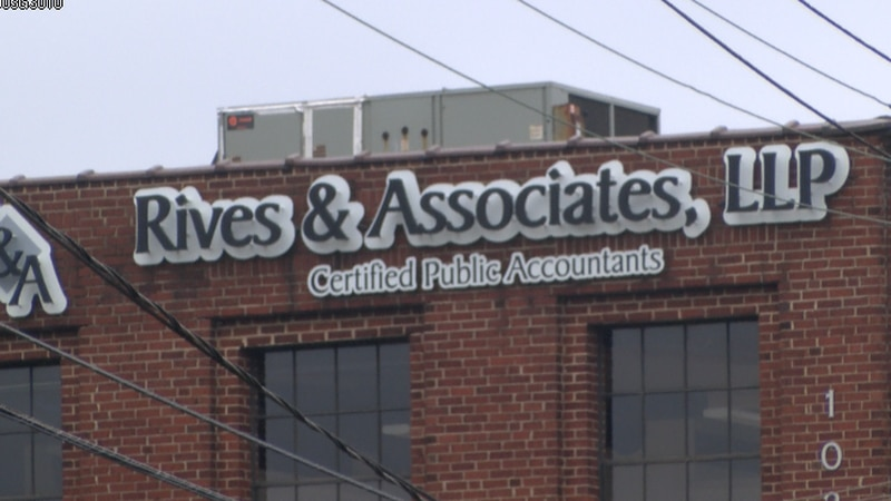 A sign sits atop the building that houses Rives & Associates' office in Charlotte