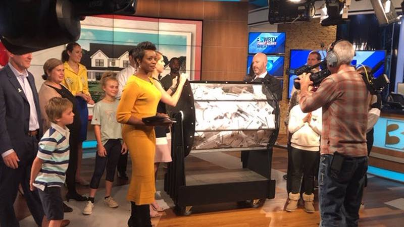 WBTV's Christine Sperow announces the winners of the St. Jude Dream Home Giveaway.
