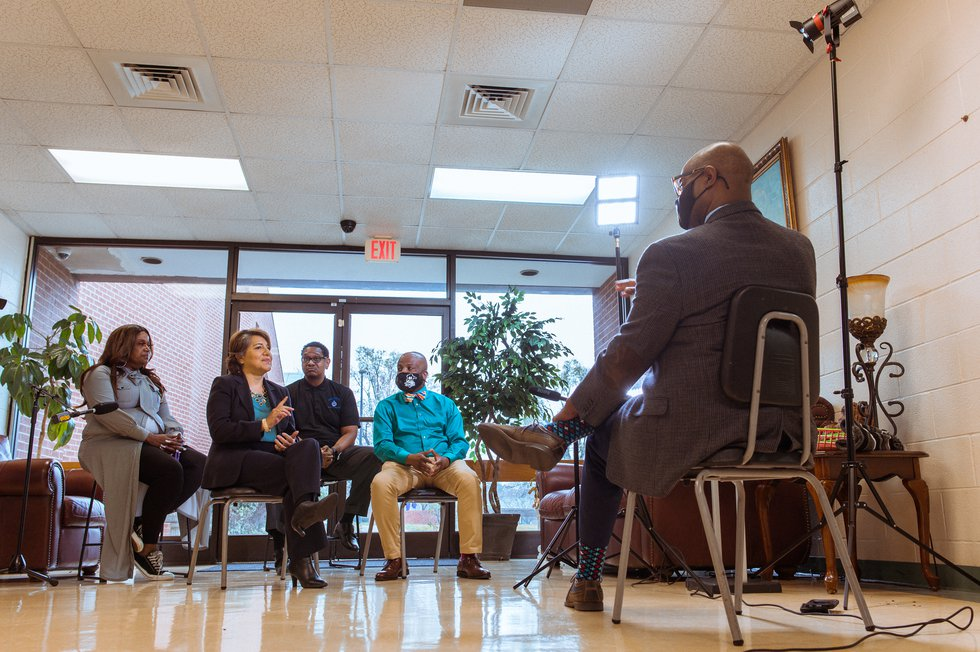 Dedrick Russell meets with individuals to talk about why they aren't getting the vaccine