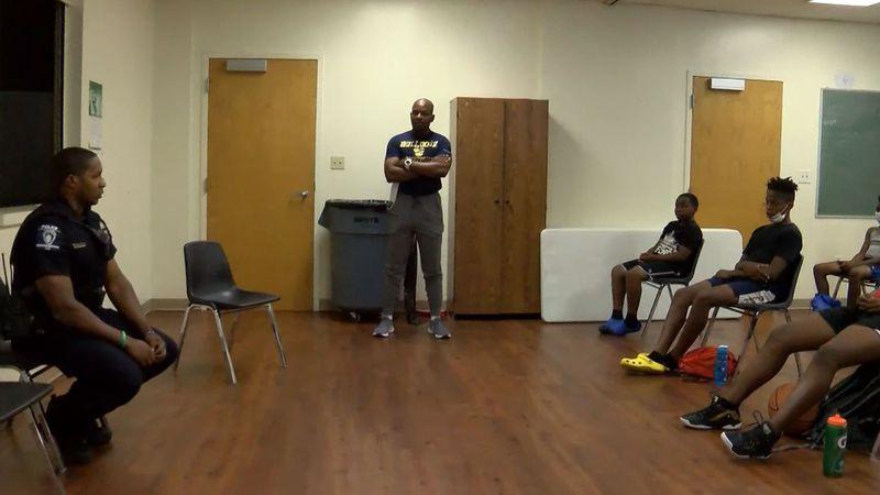 CMPD officer Darrion Eichelberger talks to the NC Bulldogz AAU basketball team.