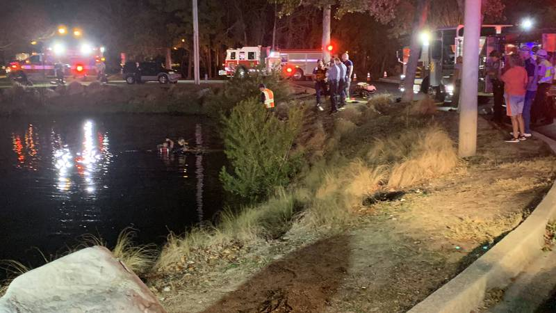 Crews respond to a vehicle submerged in water along Highway 17 Bypass in Murrells Inlet.