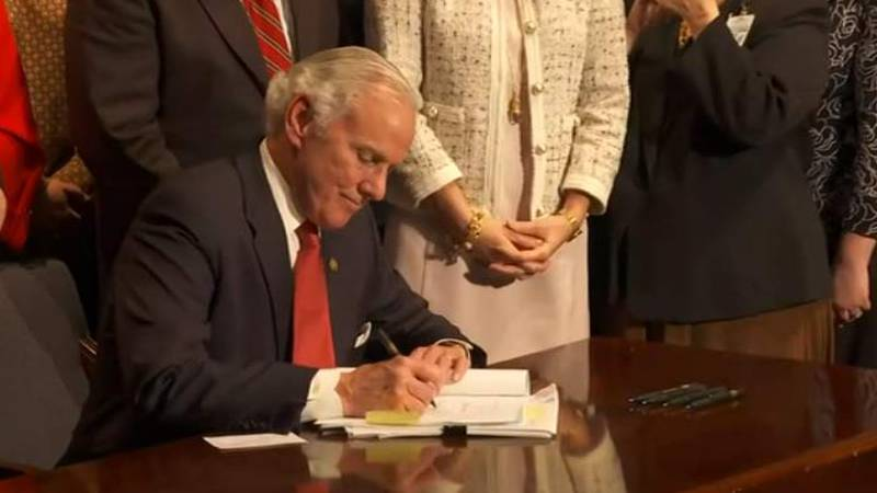 Gov. Henry McMaster signs the state's Fetal Heartbeat Bill into law at the Statehouse Thursday...