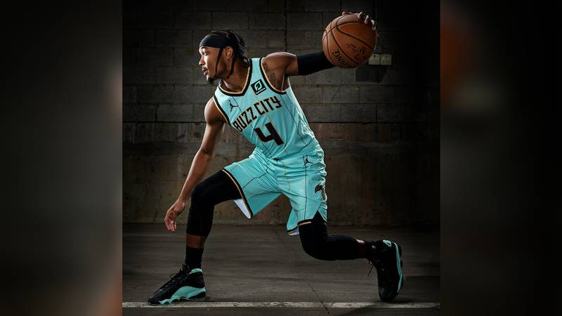 Hornets point guard Devonte' Graham showcases the team's new City Edition uniforms, wearing a...