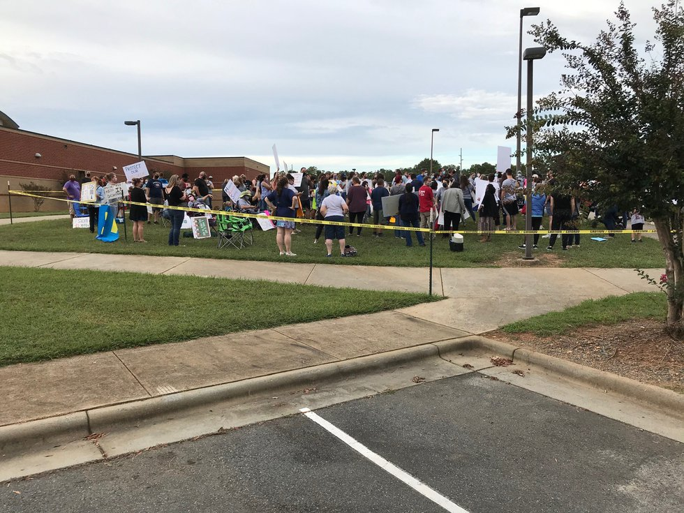 Parents protesting outside UCPS before Tuesday's meeting