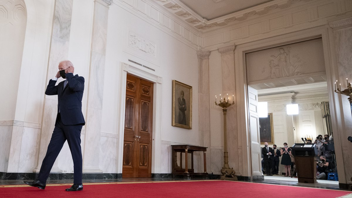 President Joe Biden walks from the podium after speaking about the end of the war in...