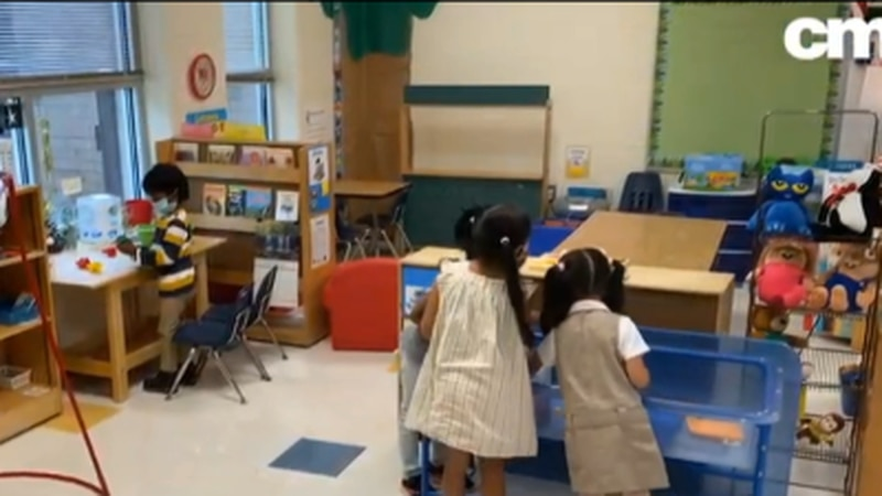 Several Pre-K students spend time in the classroom.