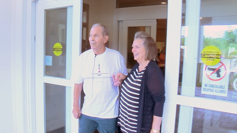 Gary Lowe walking out of Shem Creek Health Center at South Bay on Monday morning with his wife,...