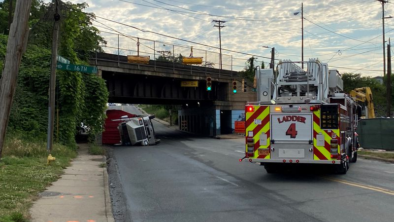 An overturned tractor-trailer closed all lanes of N Tryon Street near uptown Charlotte Monday...