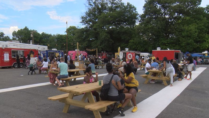 Dozens of people gathered for the Black Food Truck Friday event in west Charlotte Friday night.