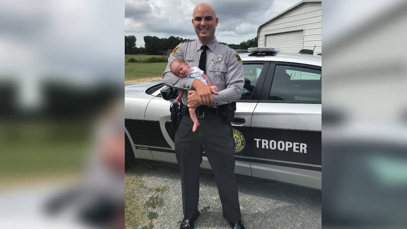 Trooper Nolan Sanders is seen here with his young daughter in front of his N.C. State Highway...