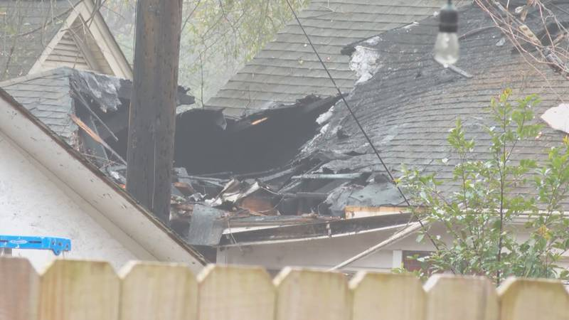 The plane hit the roof of a house before it crashed to the ground.