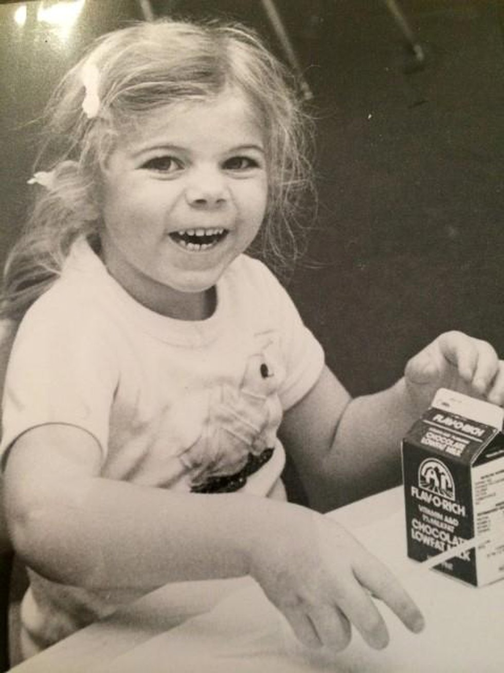 Molly Grantham smiles for chocolate milk in 1982