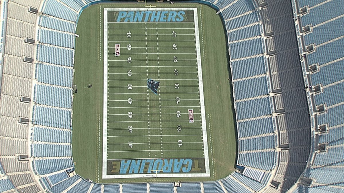 The NFL shield at the 50-yard line, long-championed by former owner Jerry Richardson, is gone.