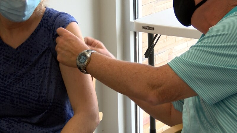 Pharmacist Greg Deese is giving flu shots to people of all ages.
