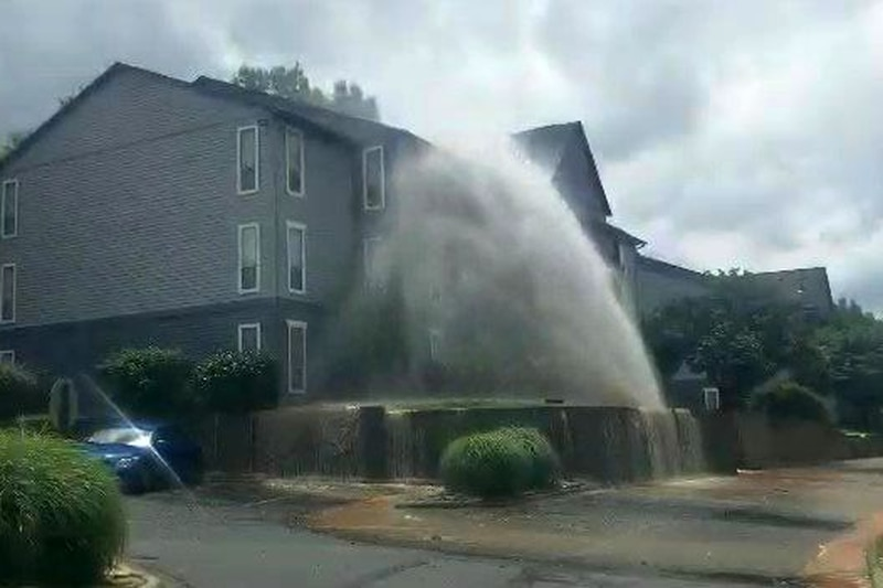 Water erupts at Arowood Crossing Apartment Homes