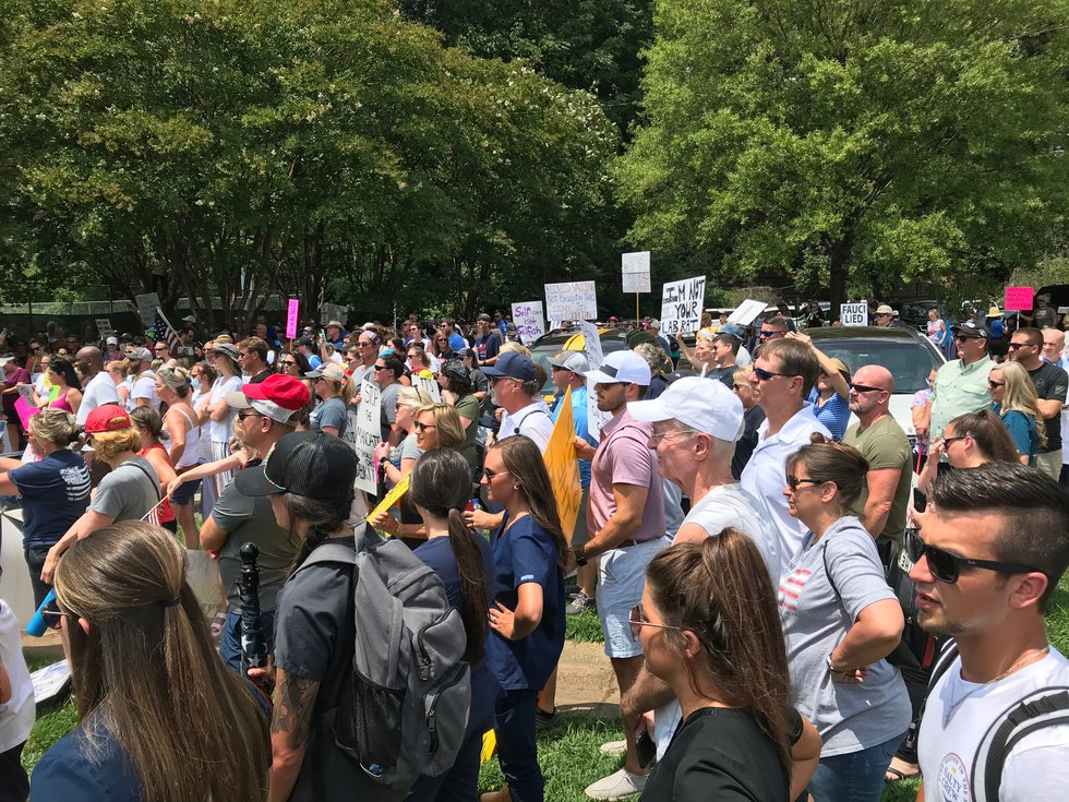 Healthcare workers, supporters march to Atrium Health in protest of employer-mandated...