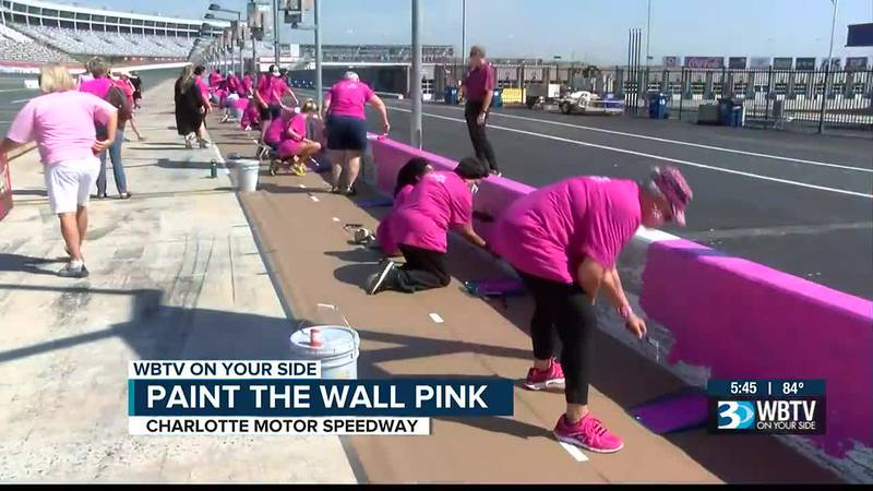 NASCAR drivers Daniel Hemric, Kurt Busch team with breast cancer survivors to paint pit wall pink