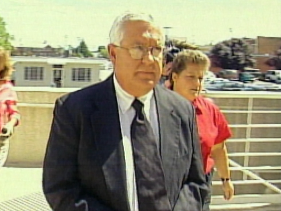 Father Ric Farwell walks into court to face criminal charges related to sexual abuse
