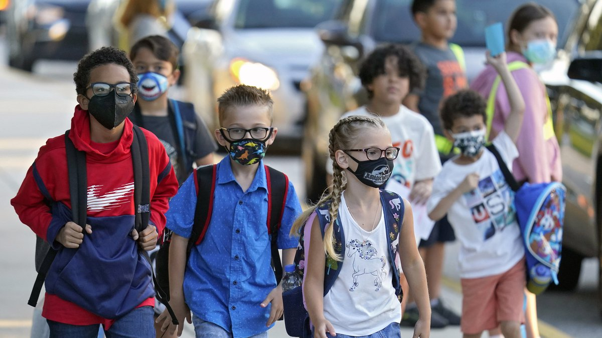 FILE - In this Tuesday, Aug. 10, 2021 file photo, Students, some wearing protective masks,...