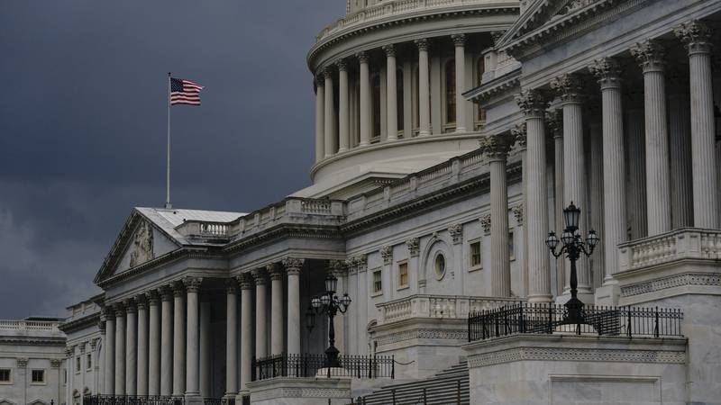 In this Aug. 3, 2020, file photo dark clouds and heavy rain sweep over the U.S. Capitol in...