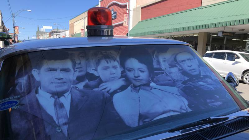 A Mayberry squad car sits on Main Street in Mount Airy waiting to take fans on another tour.
