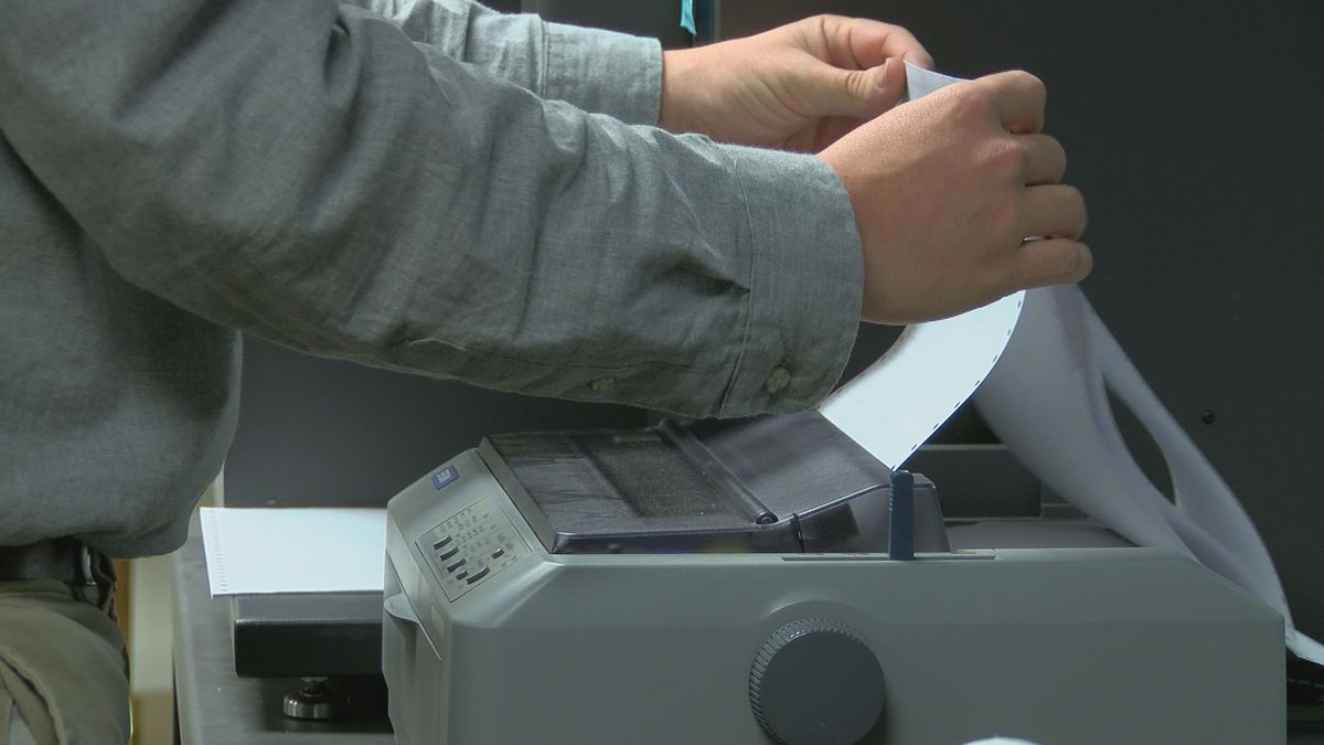 Absentee ballot results are printed at the New Hanover County Board of Elections (Source: WECT).