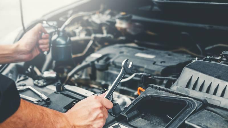 Auto mechanic working in garage Technician Hands of car mechanic working in auto repair Service...