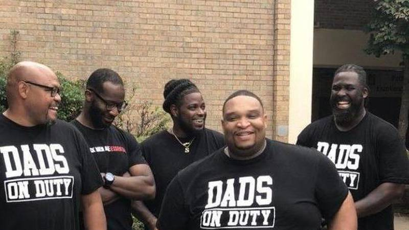 They formed Dads on Duty — a group of about 40 dads who take shifts spending time at the school...
