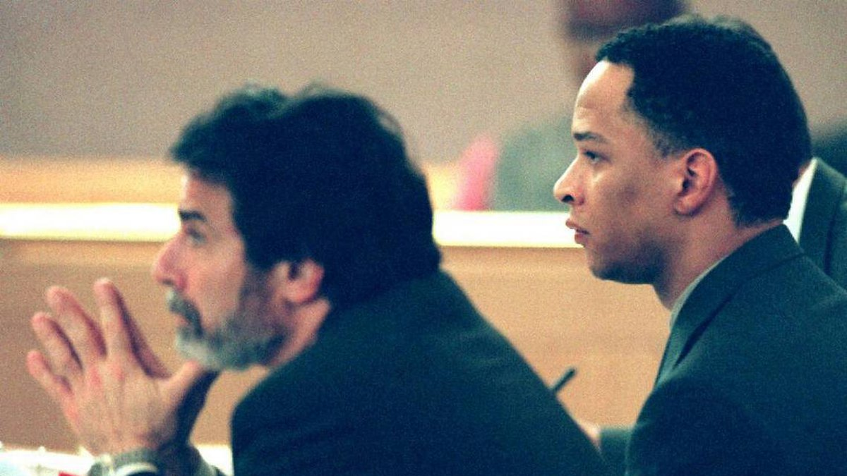 Rae Carruth, right, was represented by attorney David Rudolf, left, during his murder trial,...