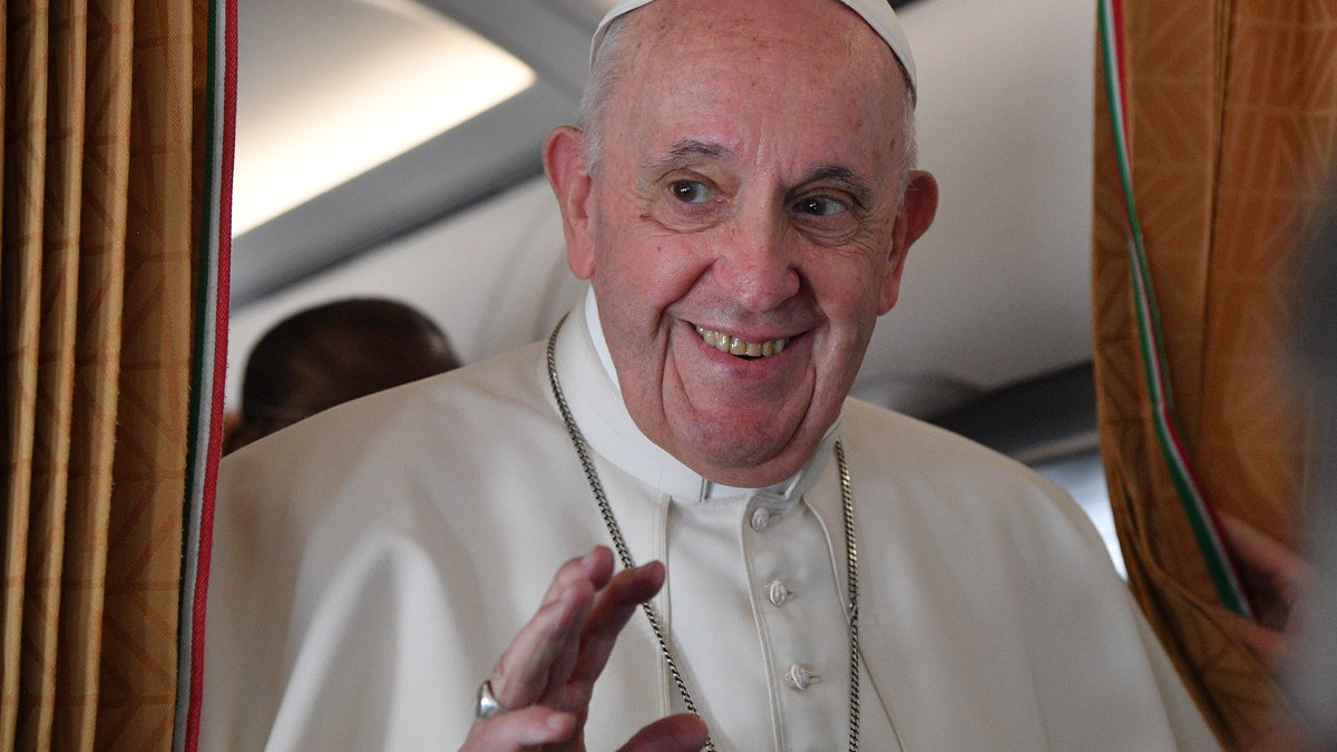 Pope Francis speaks with journalists on board an Alitalia aircraft enroute from Bratislava back...